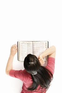 Mini-girl reading bible